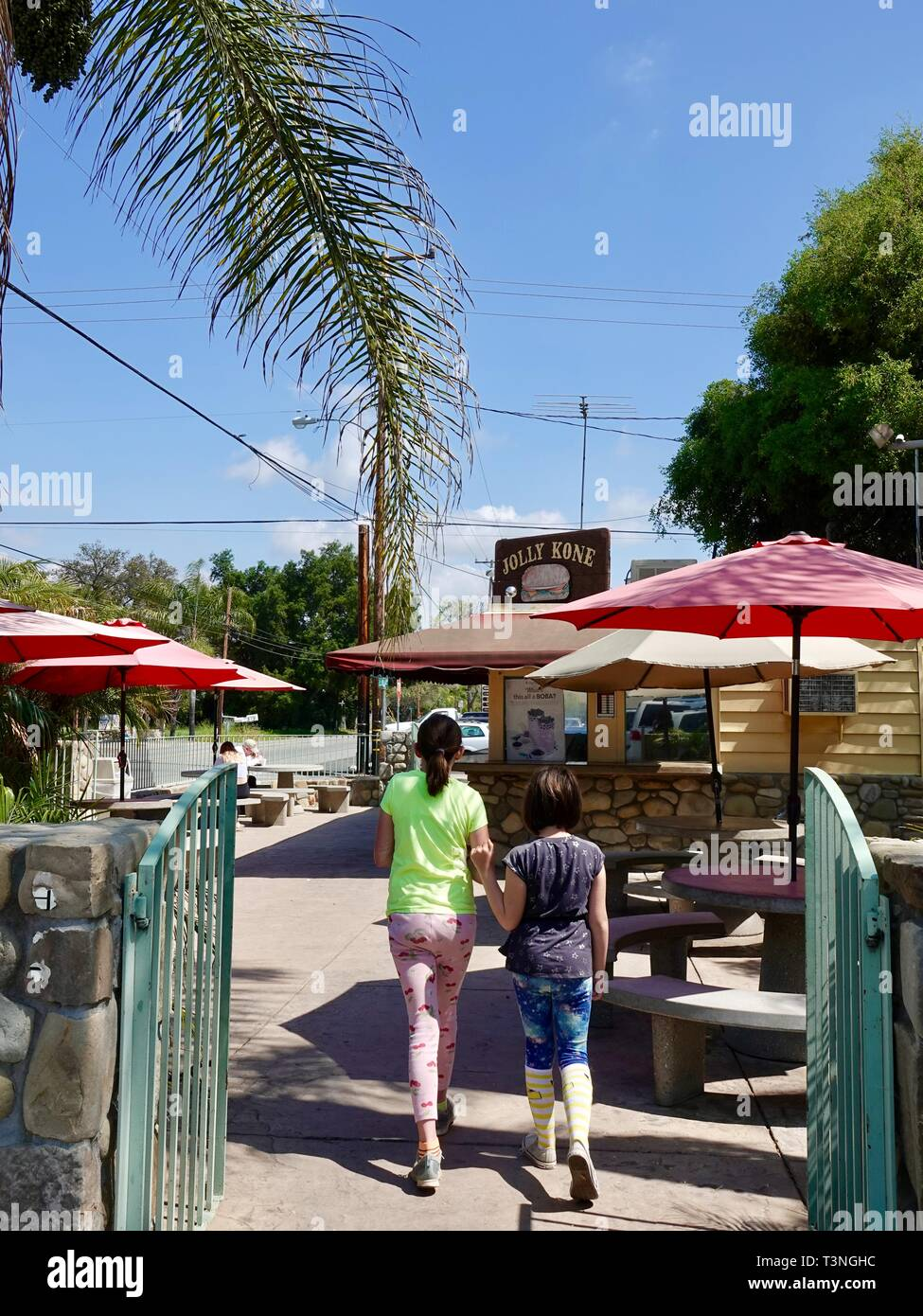 Two girls walking towards the iconic Jolly Kone restaurant in Ojai, California, USA. - Stock Image