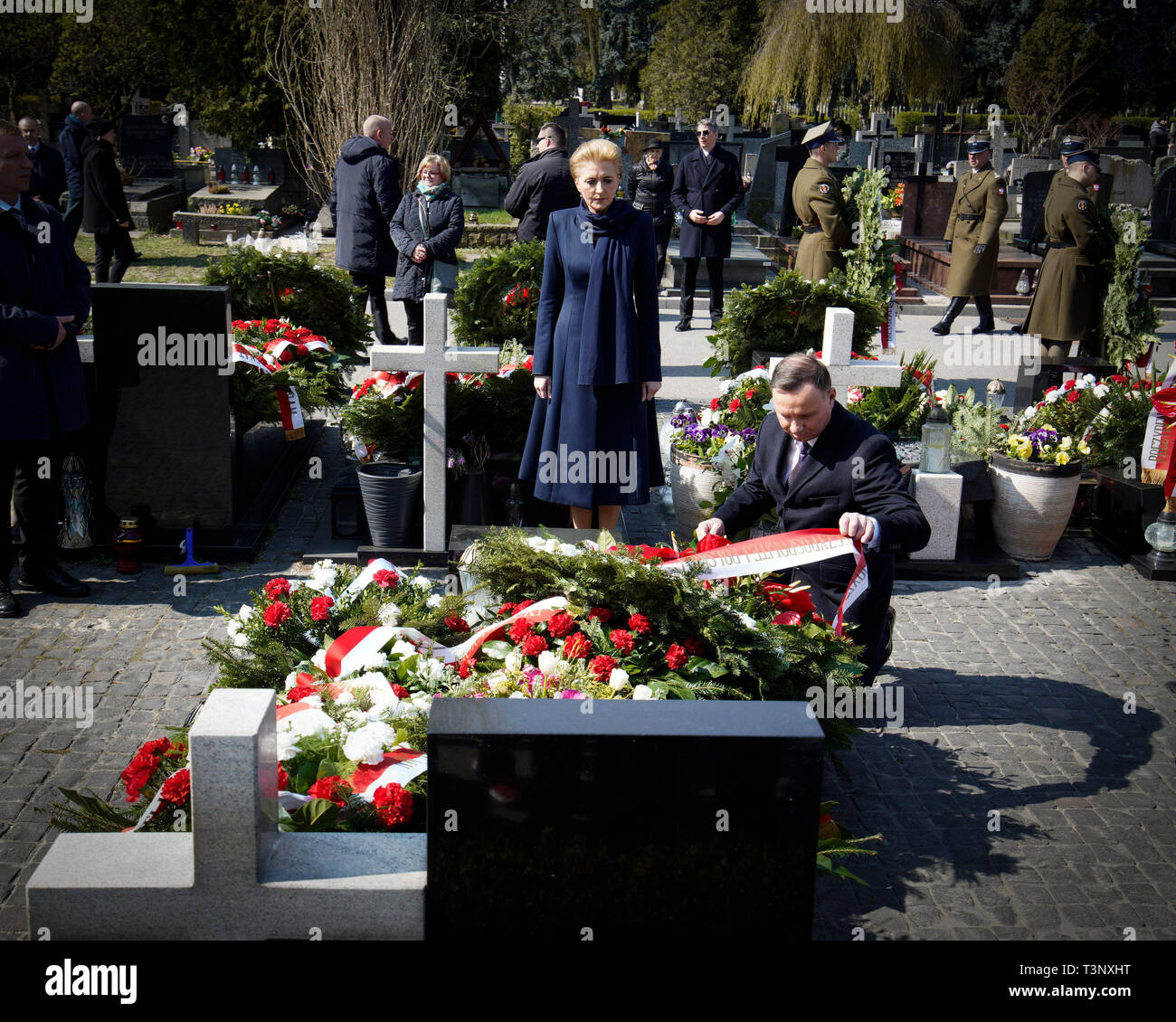 Beijing, Poland. 10th Apr, 2019. Polish President Andrzej Duda and his wife Agata Kornhauser-Duda attend a commemoration ceremony of the ninth anniversary of the Smolensk plane crash, which killed 96 people, including former Polish President Lech Kaczynski, in Warsaw, Poland, on April 10, 2019. Credit: Jaap Arriens/Xinhua/Alamy Live News - Stock Image