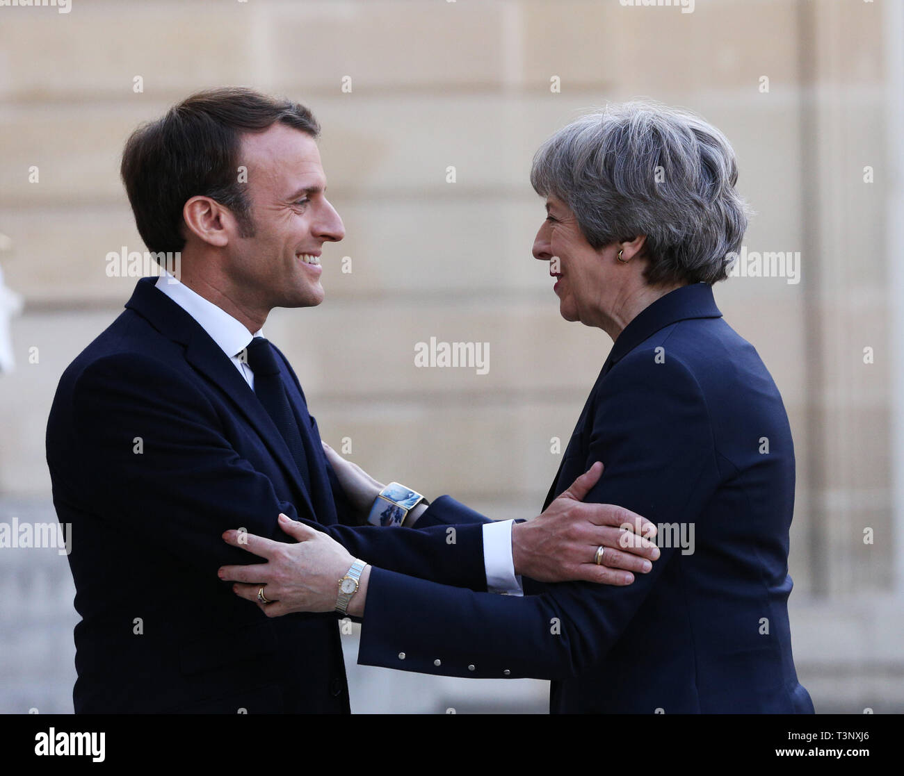Beijing, France. 9th Apr, 2019. French President Emmanuel Macron (L) welcomes visiting British Prime Minister Theresa May at the Elysee Palace in Paris, France, April 9, 2019. Credit: Gao Jing/Xinhua/Alamy Live News - Stock Image