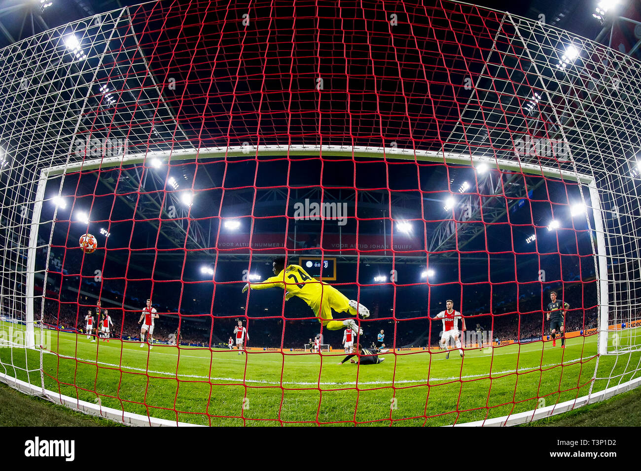 AMSTERDAM, Football,10-04-2019, Stadium Johan Cruyff Arena. Champions League quarter finals first leg Ajax - Juventus, Juventus player Cristiano Ronaldo (M) scores 0-1, Ajax goalkeeper Andre Onana (5L) - Stock Image