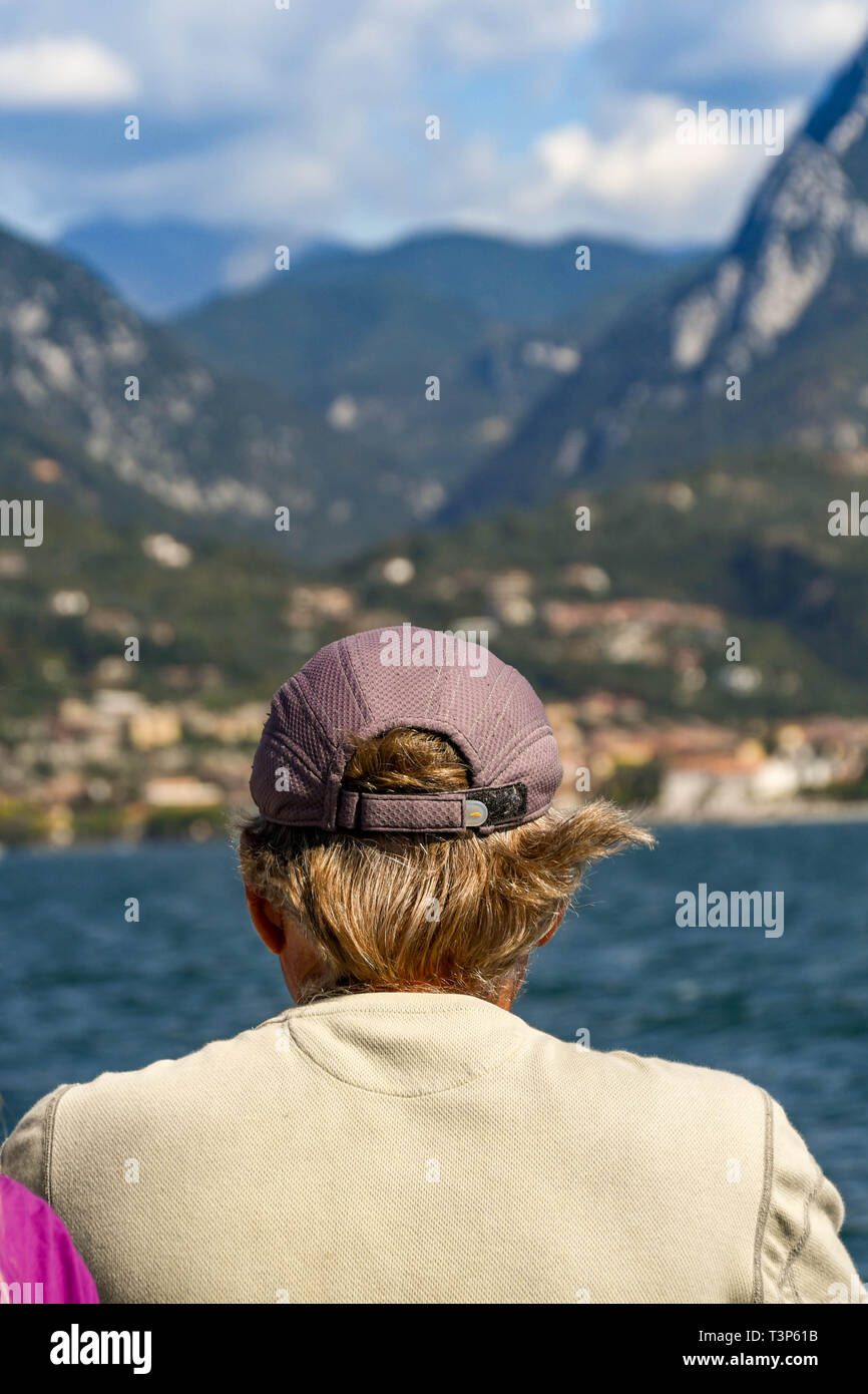 LAKE GARDA, ITALY - SEPTEMBER 2018: Person looking out at the scenery from a ferry on Lake Garda. - Stock Image