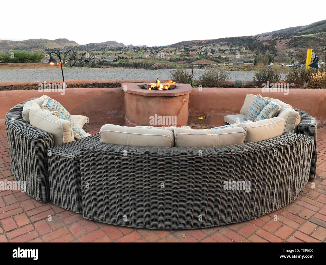 Outdoor Fire Pit With Circular Wicker Seating And Cushions The Photo Was Taken In The Early Evening When The Sky Had A Soft Pink And Orange Color On Stock Photo Alamy
