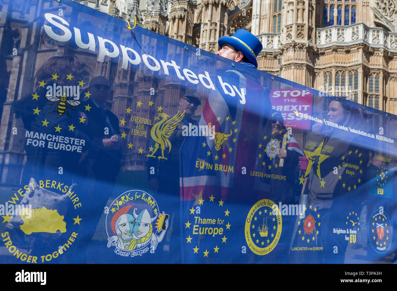 On the day that Prime Minister Theresa May returns to Brussels to negotiate an expected Brexit delay, pro-EU remainers protest outside parliament in Westminster, in London, England. - Stock Image