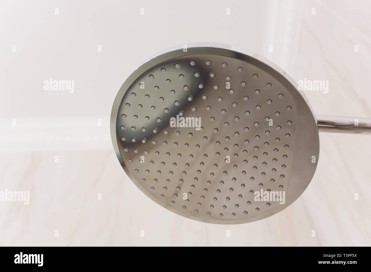 detail of a corner shower cabin with wall mount shower attachment. - Stock Image
