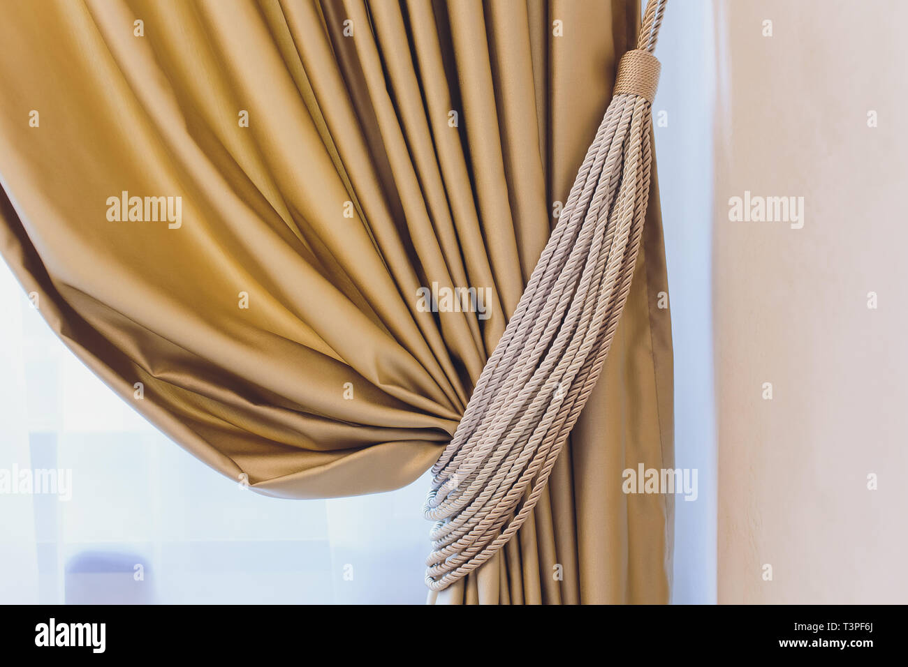 Holder for room curtains. Fragment photo curtain, interior detail, curtain detail close up. - Stock Image
