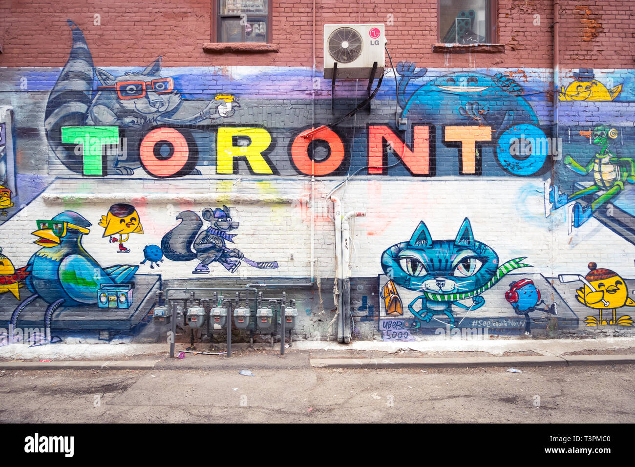 Brilliant urban art and murals on Graffiti Alley (Rush Lane), in the Queen Street West district of Toronto, Ontario, Canada. - Stock Image