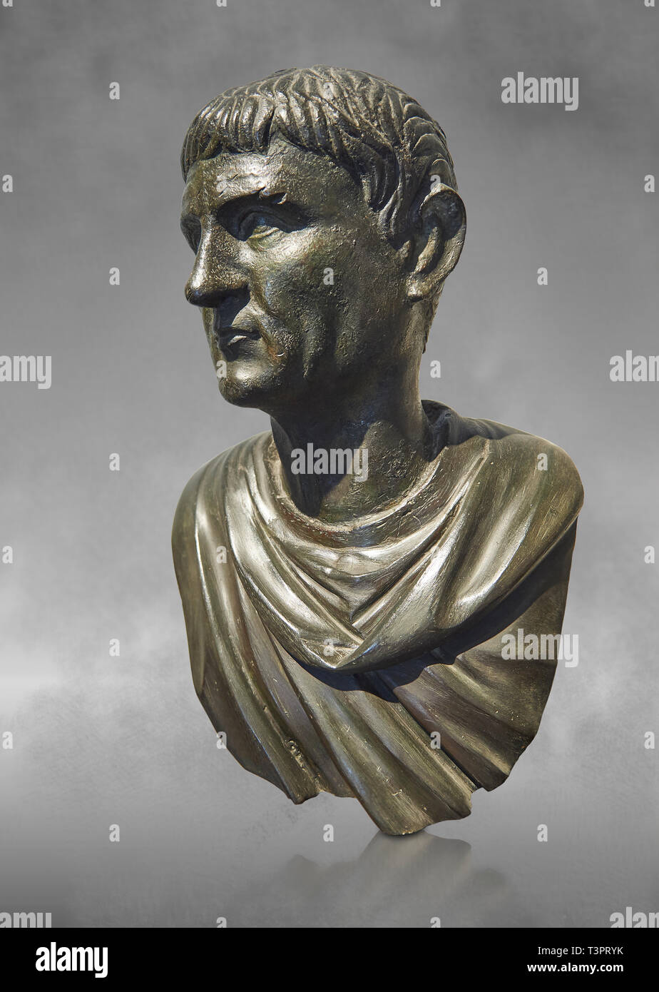 Roman Bronze sculpture bust known as 'Sylla' from the tablinium of the Villa of the Papyri in Herculaneum, Museum of Archaeology, Italy, grey art back - Stock Image