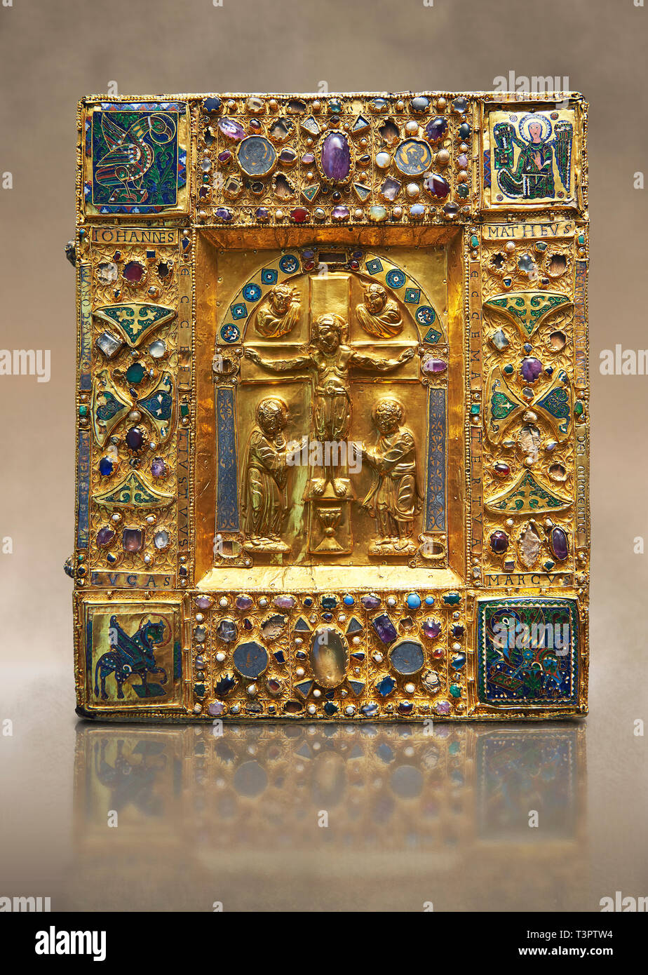 Medieval gilded manuscript cover depicting the Crucifixion. 11th century from the treasury of the Cathedral of Maastricht. AD.   This gilded with reli - Stock Image