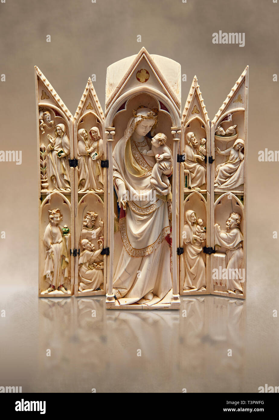 Medieval Gothic ivory tabernacle depicting the Virgin and Child with scenes from the Annunciation, Nativity, the adoration of the Magi and the present - Stock Image