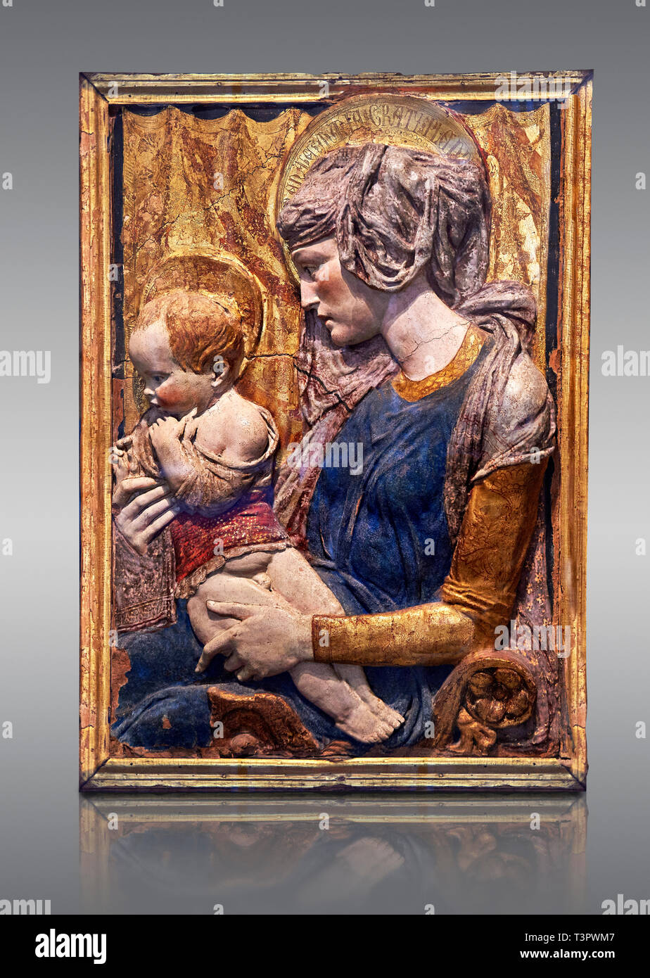 Painted terracotta relief panel depicting the Virgin and Child by Niccolo Bardi better known as Donatello. Made in Florence around 1386. Inv RF 353, T Stock Photo