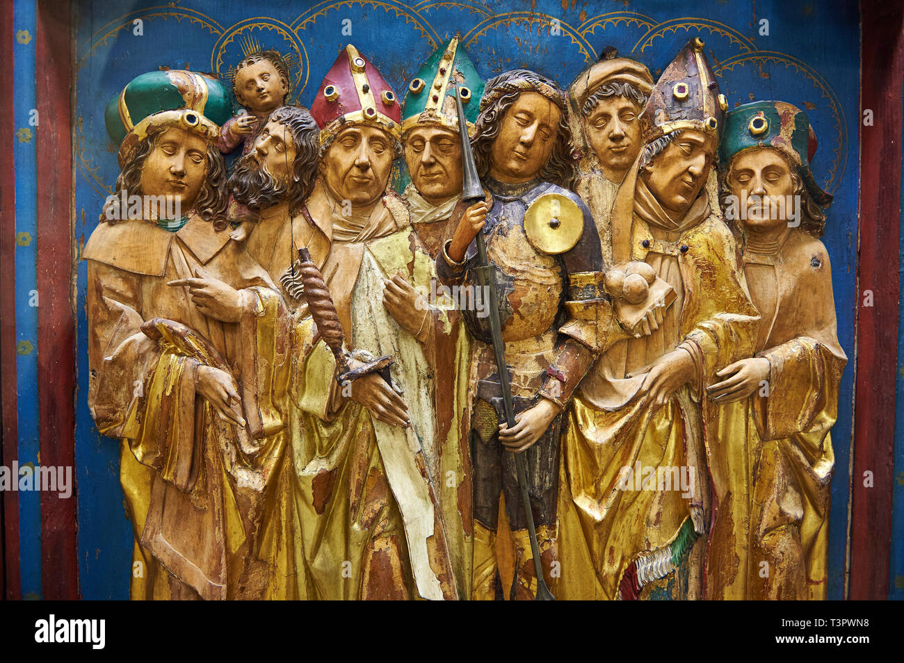 Painted Gothic wooden Fourteen Intercessors altarpiece made at the end of the 15th century in Franconia.  The panel depict 14 saints in total. Inv RF  Stock Photo