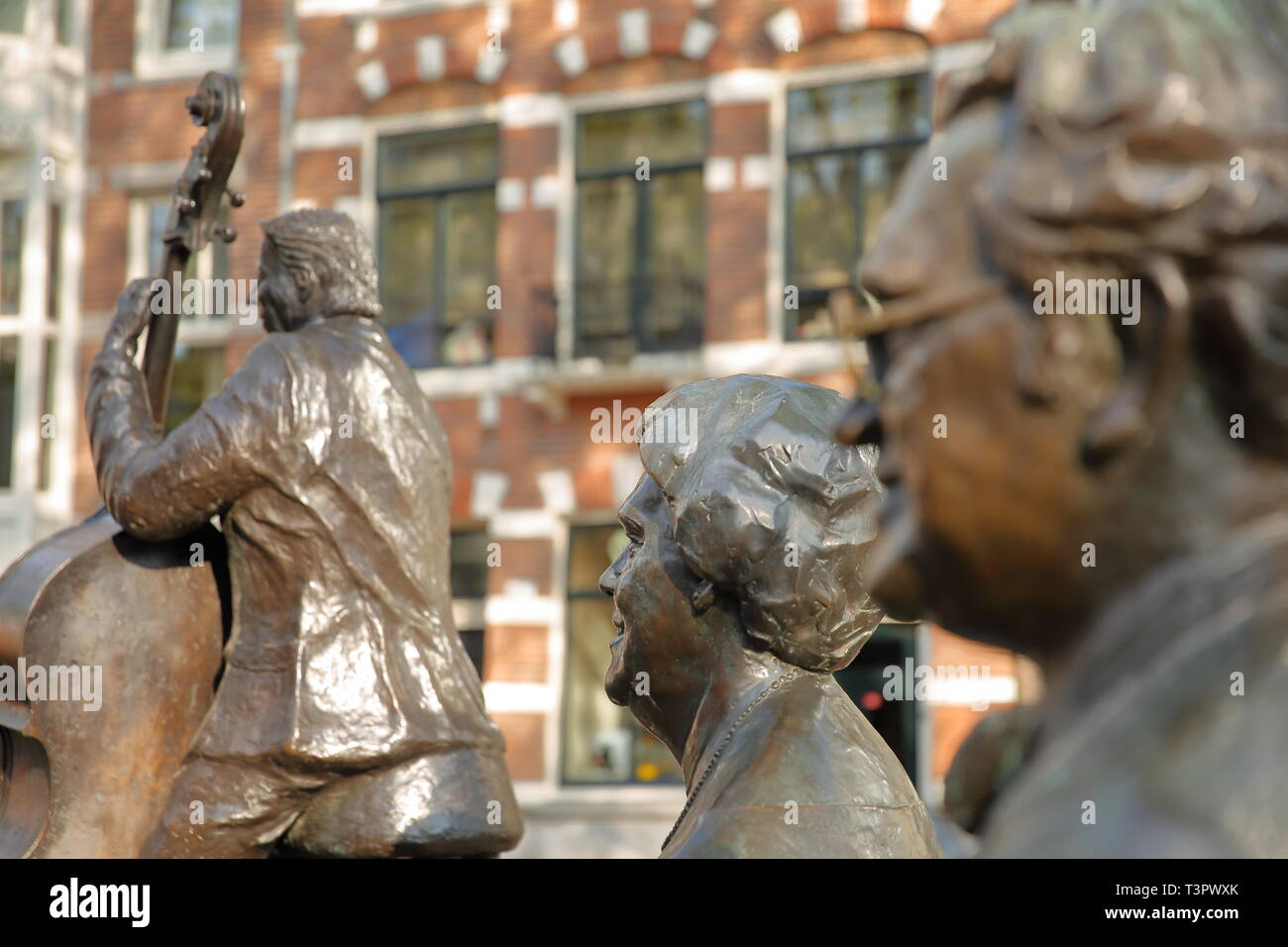AMSTERDAM, NETHERLANDS - APRIL 05, 2019: Bronze Sculptures of famous Dutch musicians and singers, located on Elandsgracht (close to Prinsengracht cana - Stock Image