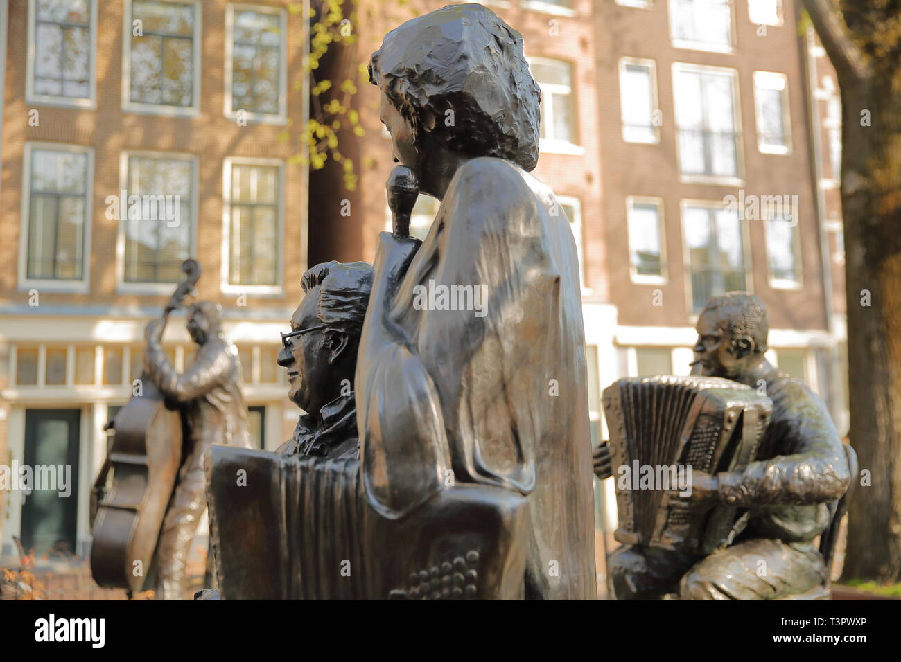 AMSTERDAM, NETHERLANDS - APRIL 05, 2019: Bronze Sculpture of famous Dutch singer Jan Froger, located on Elandsgracht (close to Prinsengracht canal) - Stock Image