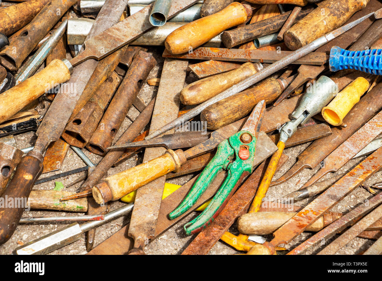 Disorderly scattered various hand work tools, files and rasps, hand tool texture background - Stock Image
