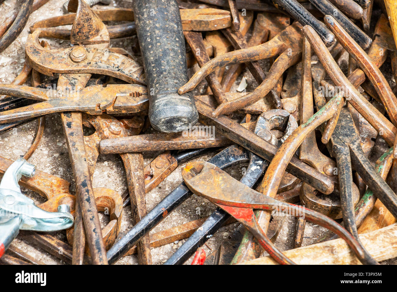Disorderly scattered various pliers, hand tool texture background - Stock Image