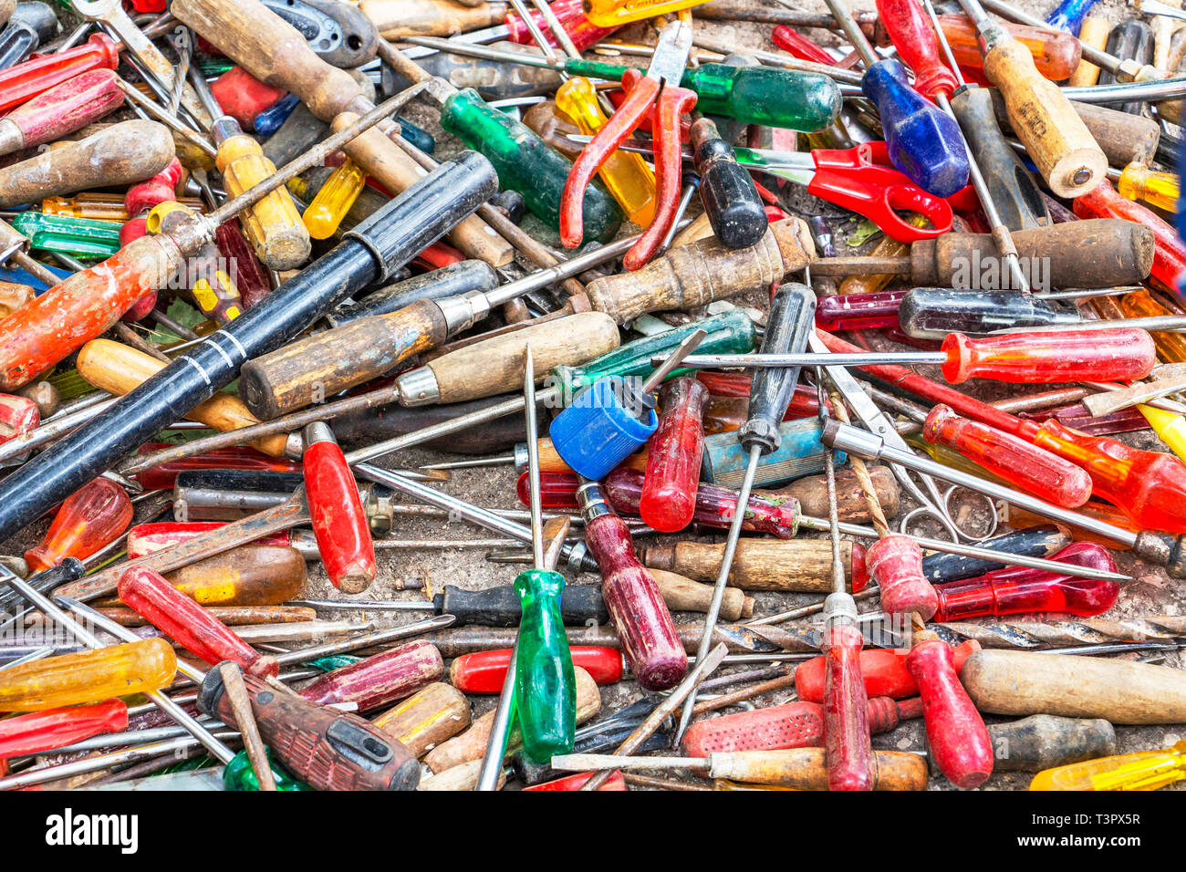 Disorderly scattered various hand tools, screwdrivers, hand tool texture background - Stock Image