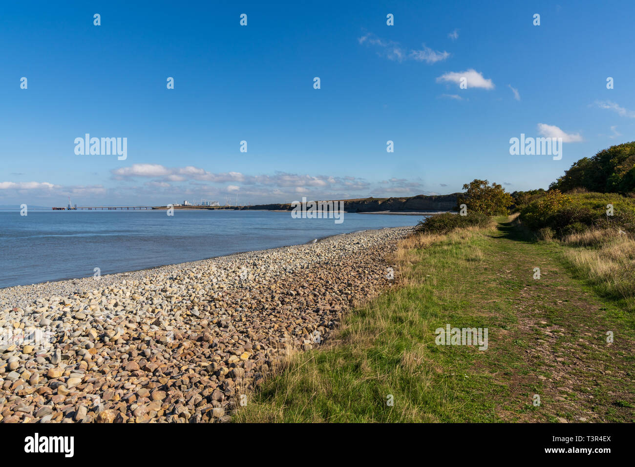 Lilstock Beach, Somerset, England, UK - October 04, 2018: Looking over the Bristol Channel with Hinkley Point Nuclear Power Station in the background - Stock Image