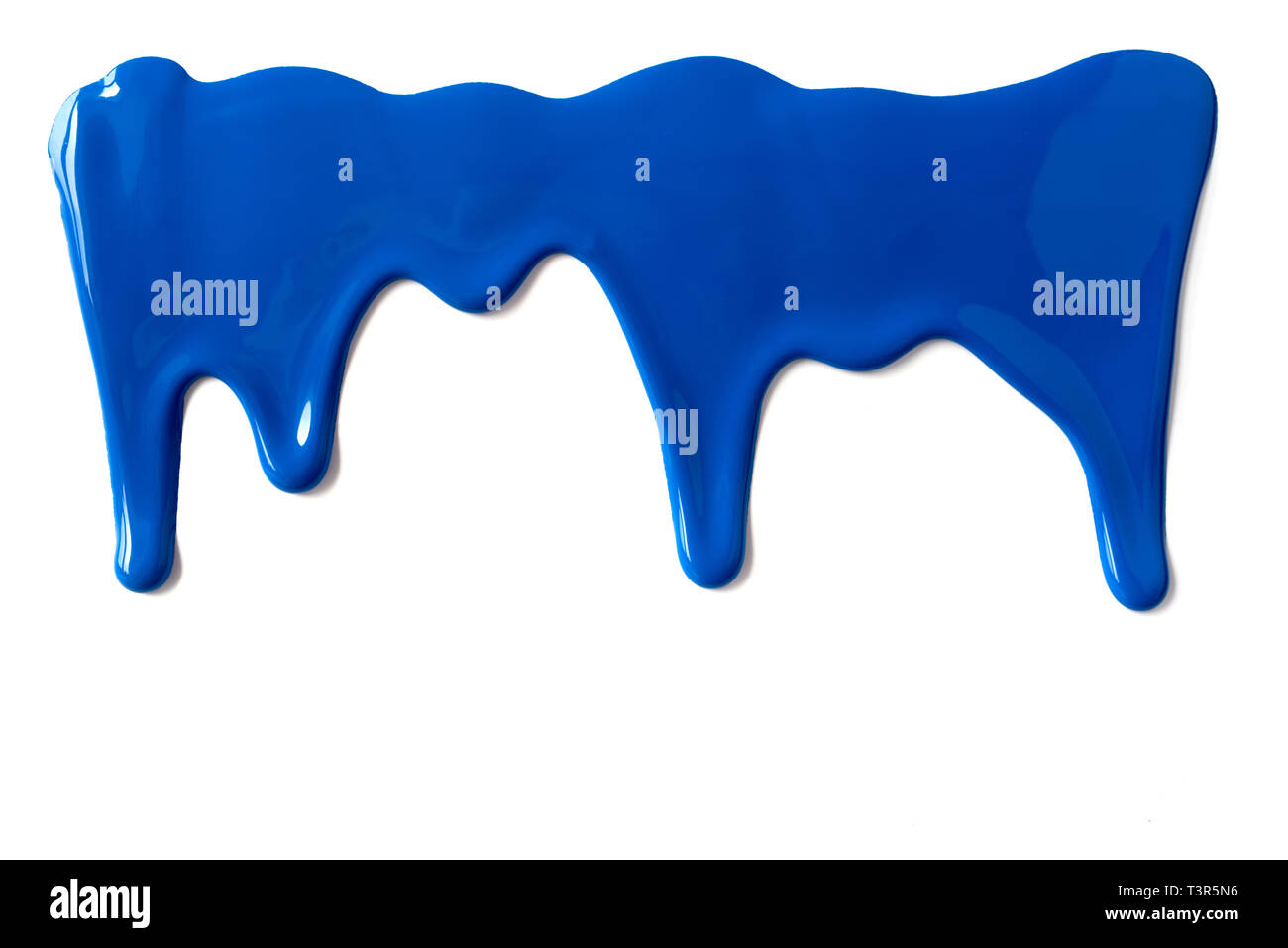 Blue paint leaking down white background. Close up. - Stock Image