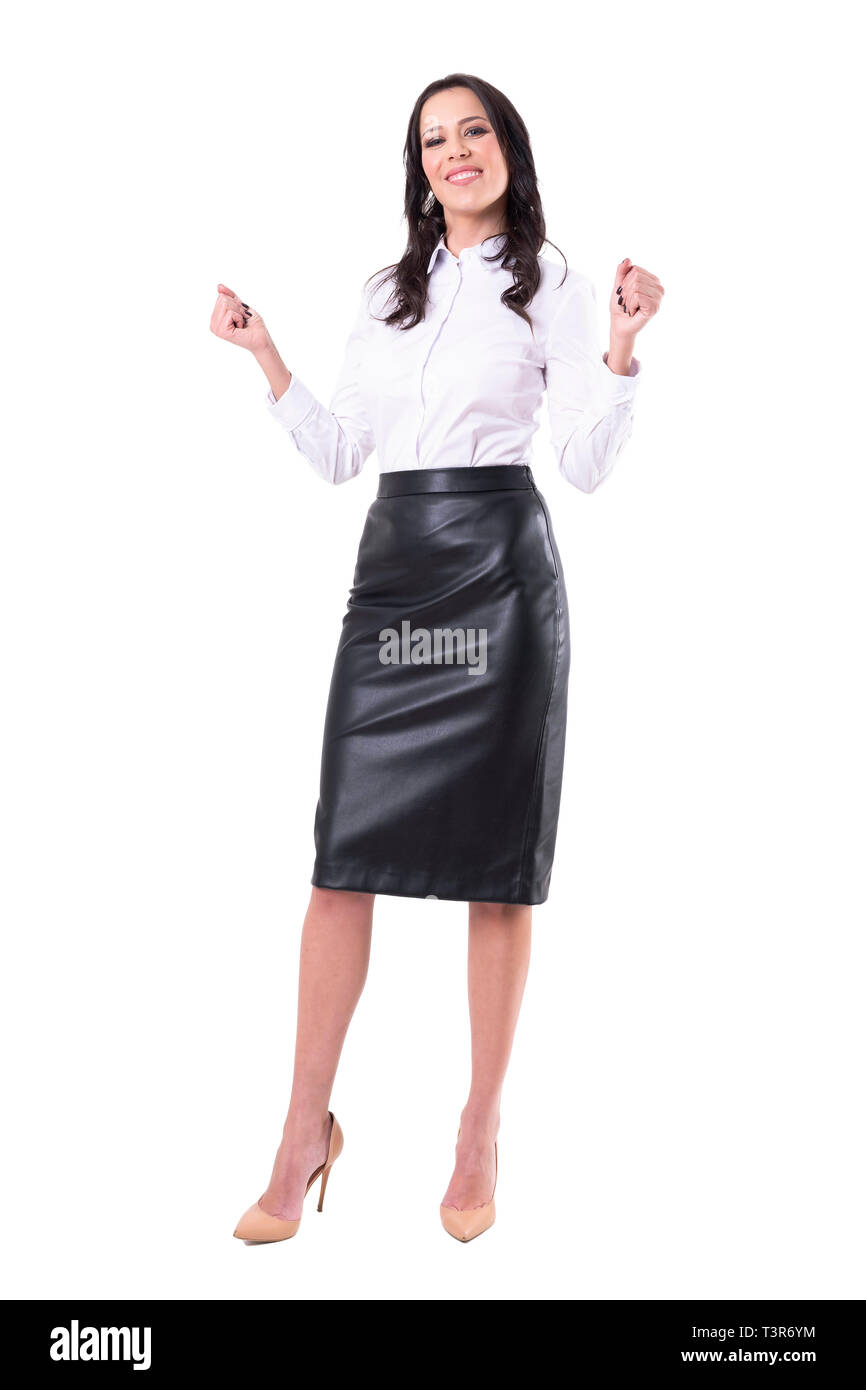 Excited happy elegant pretty business woman celebrating success with clenched fists. Full body isolated on white background. - Stock Image