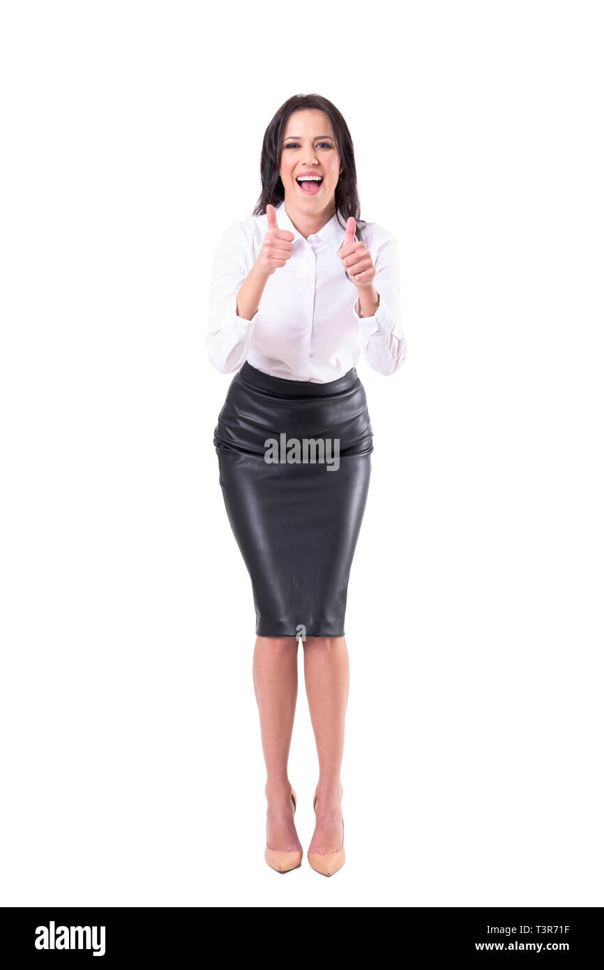 Gleeful excited business woman showing thumbs up congratulating and cheering. Full body isolated on white background. - Stock Image