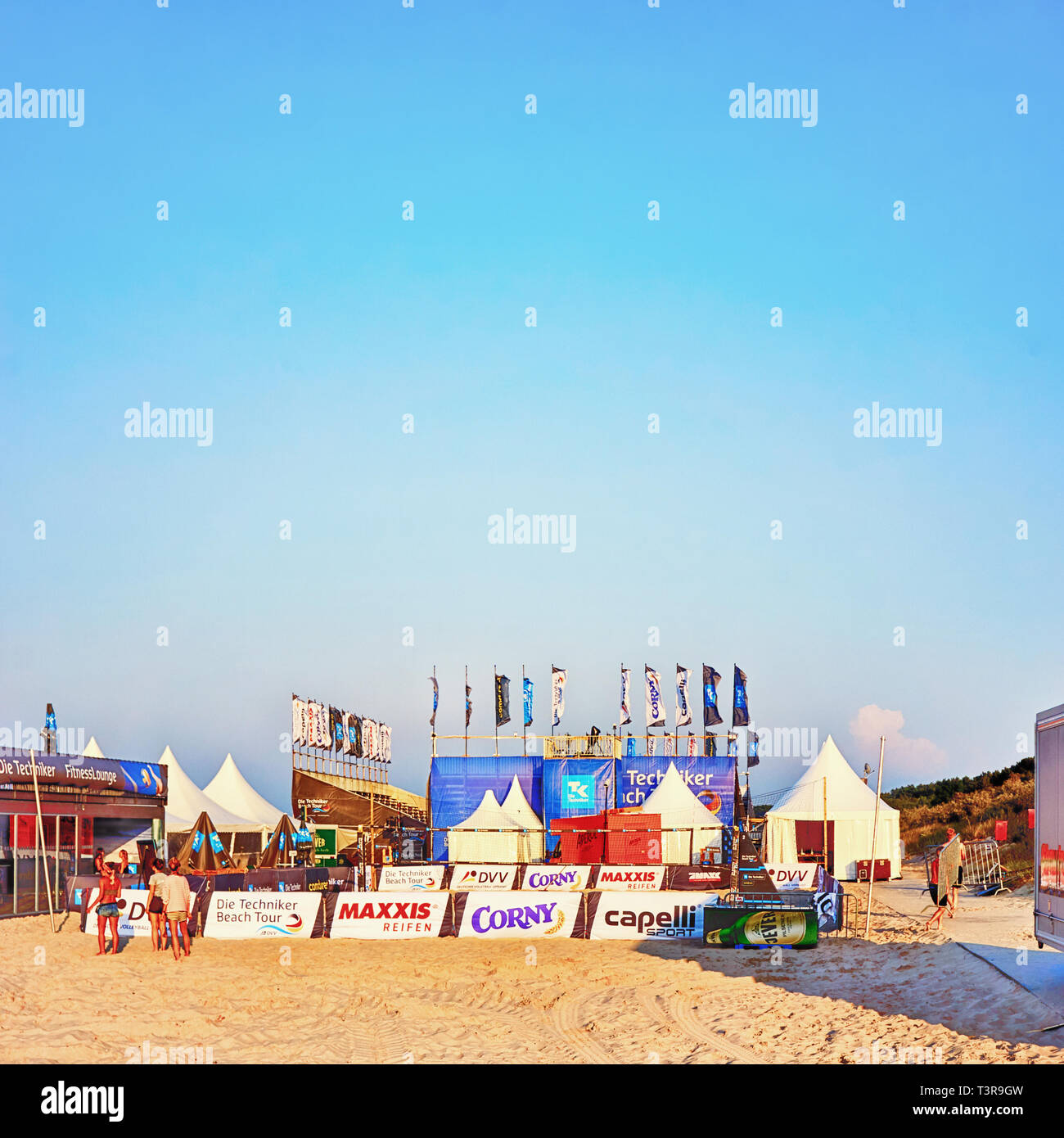 Advertising signs on the beach at a beach volleyball tournament. Jever, Corny, Maxxis, Die Techniker, DVV, capelli - Stock Image