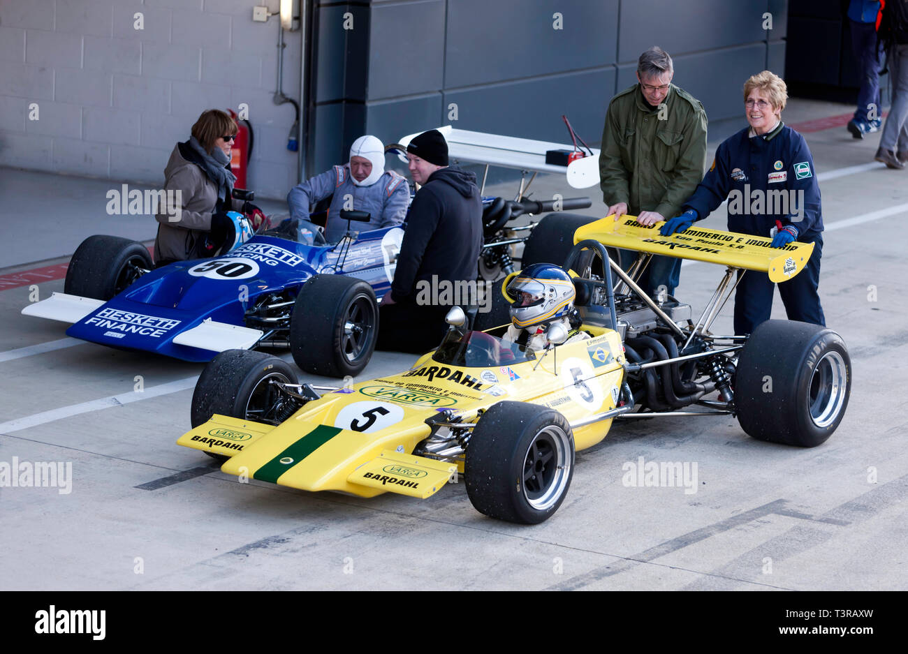 Roger Bevan sitting in his Yellow,1971 Lotus 69, previously driven by Emmerson Fittipaldi, during the 2019 Silverstone Classic Media/Testy Day - Stock Image