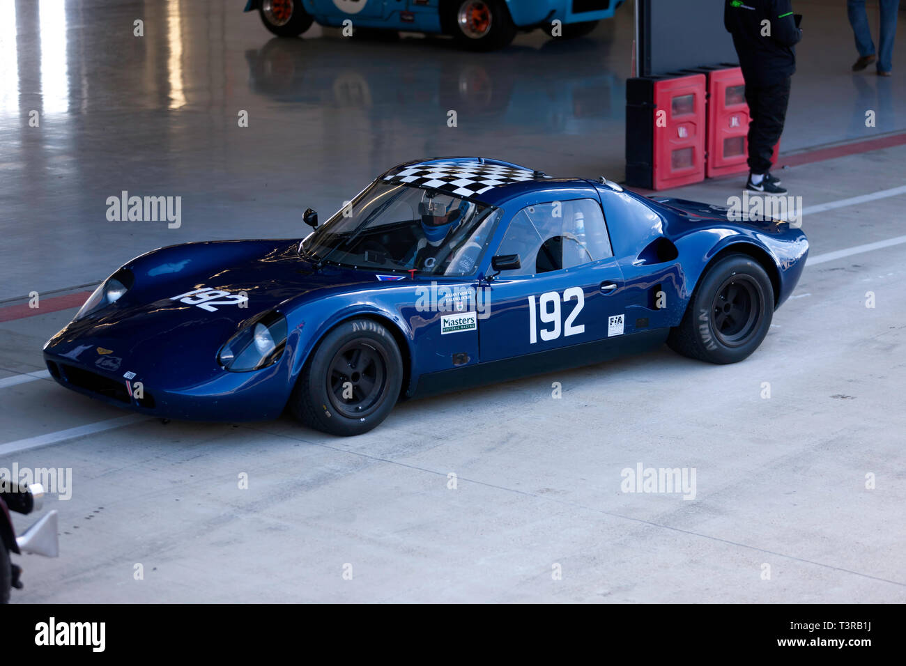 A Blue, 1968, Chevron B8 in the pit lane, during the Silverstone Classic Media Day 2019 - Stock Image