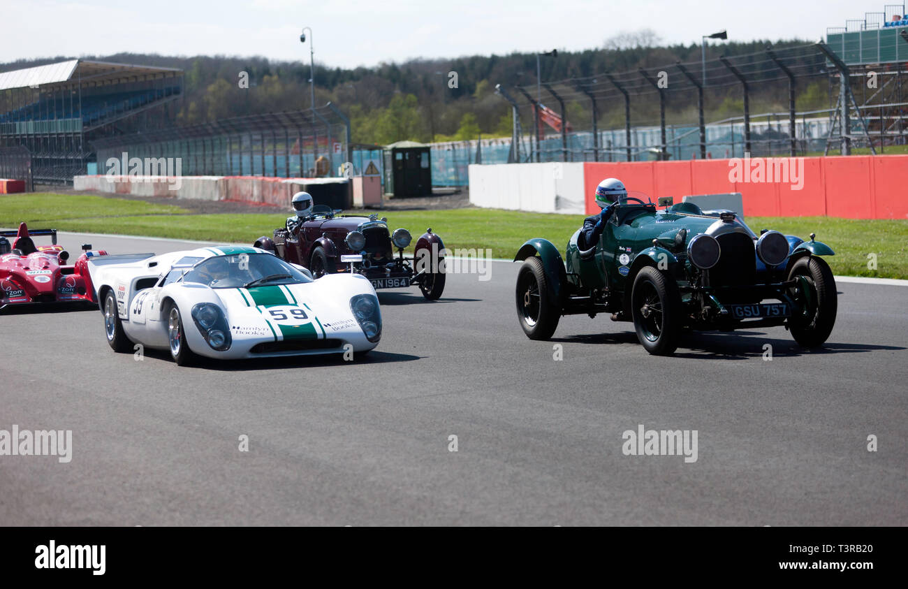 Race cars from different eras parade around the track, during the 2019 Silverstone Classic Media Day - Stock Image