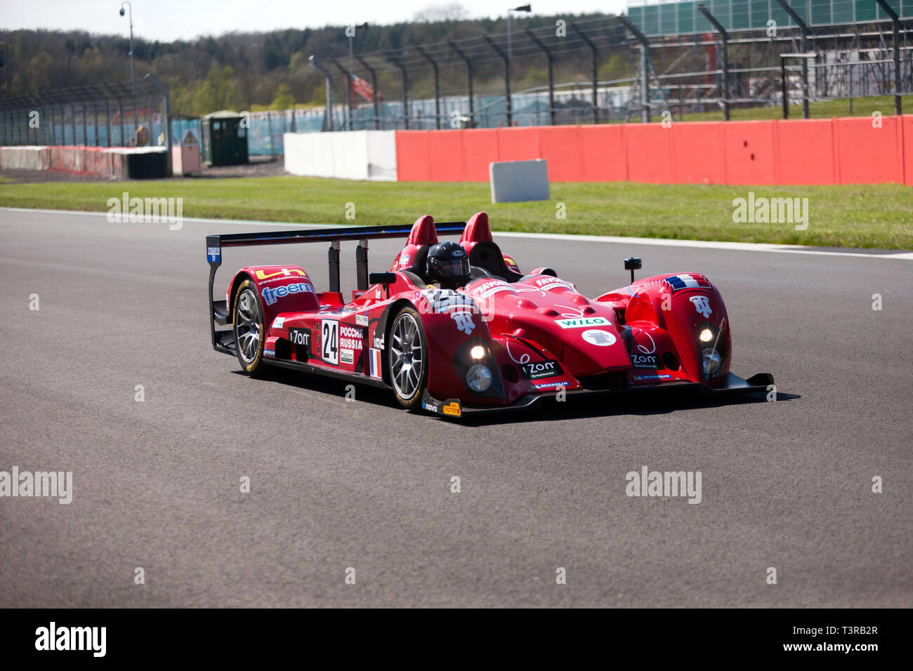 Mike Furness driving his 2007, Courage LC75,  down the International Pit Lane, during the 2019  Silverstone Classic  Media Day /Test Day - Stock Image