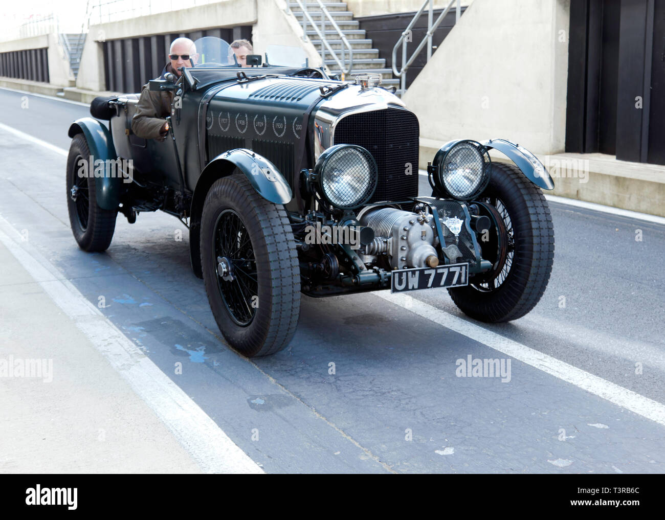 A green, 1929 Pre-War Blower Bentley in the pit lane as part of the Bentley Centenary Celebrations at the 2019 Silverstone Classic media Day - Stock Image