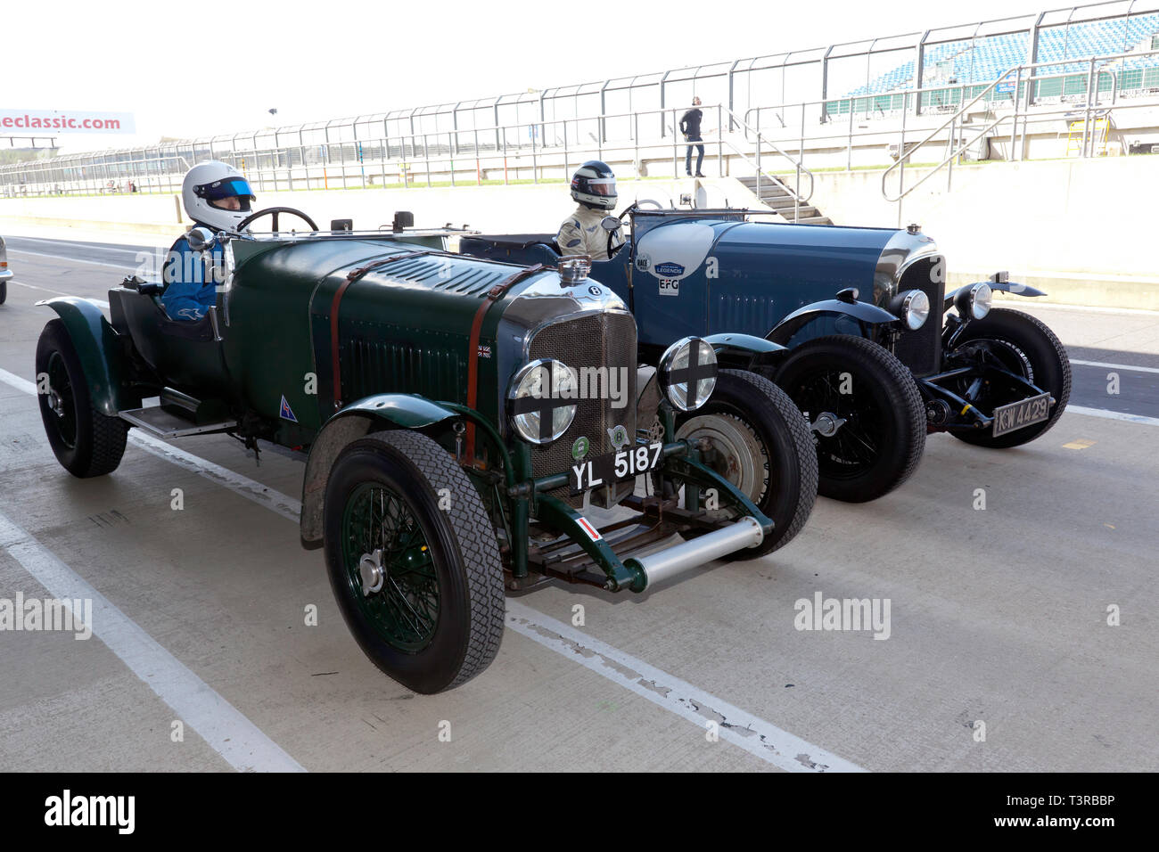 Two Pre-war Bentley Race Cars line up on the International pit lane,  to take part in a parade lap as part of the Centenary Celebrations, at the Silverstone Classic Media Day 2019 - Stock Image
