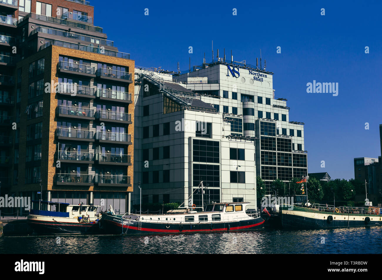 London, UK - July 23, 2018: Houseboats moored in the Millwall Outer Dock , Isle of Dogs. Housebat is a boat that has been designed or modified to be u - Stock Image