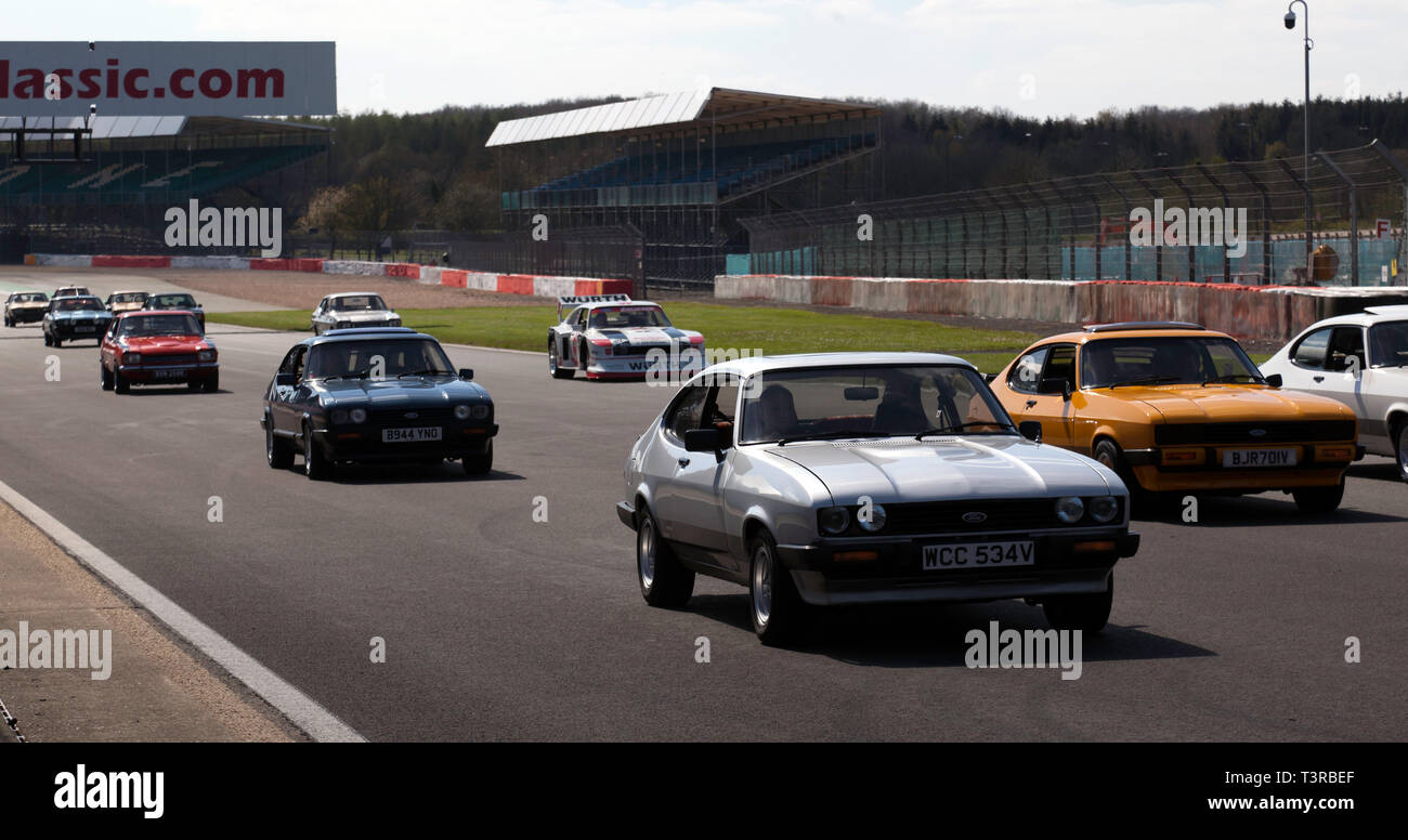 A parade lap at the Silverstone Classic Media Day 2019, celebrating the 50th anniversary of the Ford Capri - Stock Image