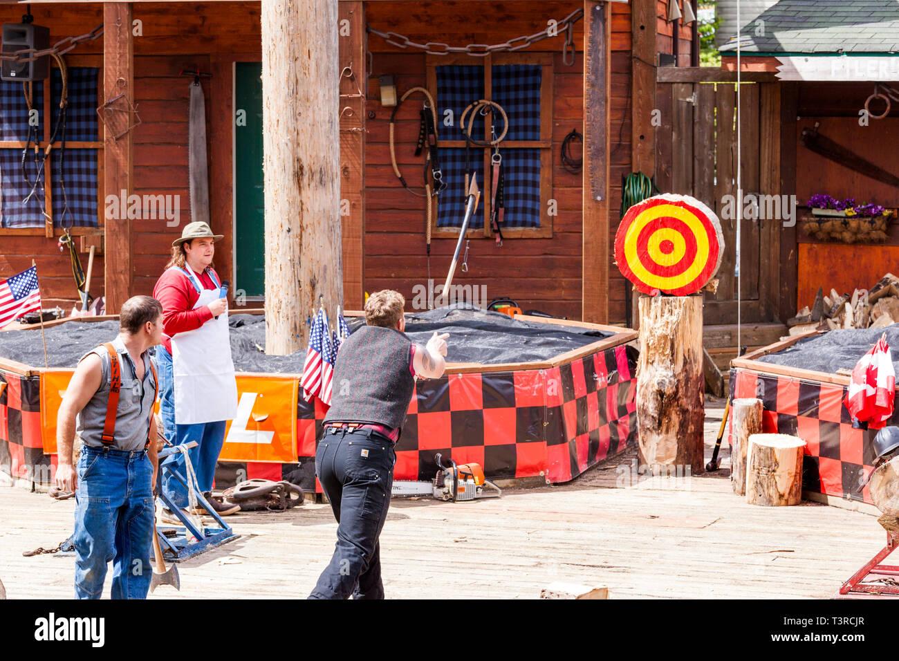 Axe throwing demonstration at the Great Alaskan Lumberjack Show in Ketchikan, Alaska USA Stock Photo