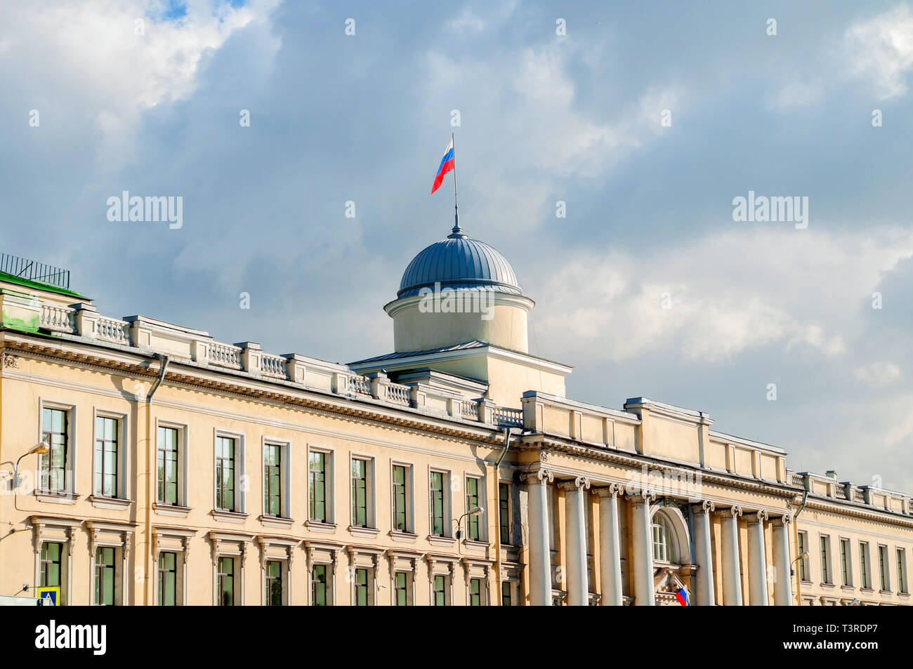 Leningrad Regional Court building on the Fontanka River in Saint Petersburg, Russia - facade view with Russian flag on the roof flagpole in sunny day - Stock Image
