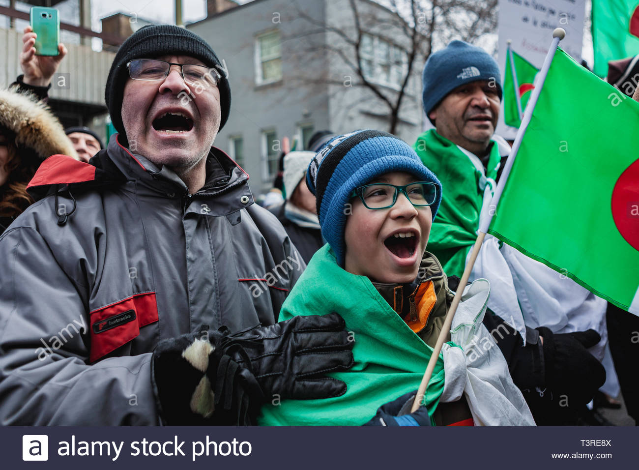 A father and his young son are screaming, during the demonstration of the Algerian diaspora demanding the departure of President Bouteflika. Montreal, - Stock Image