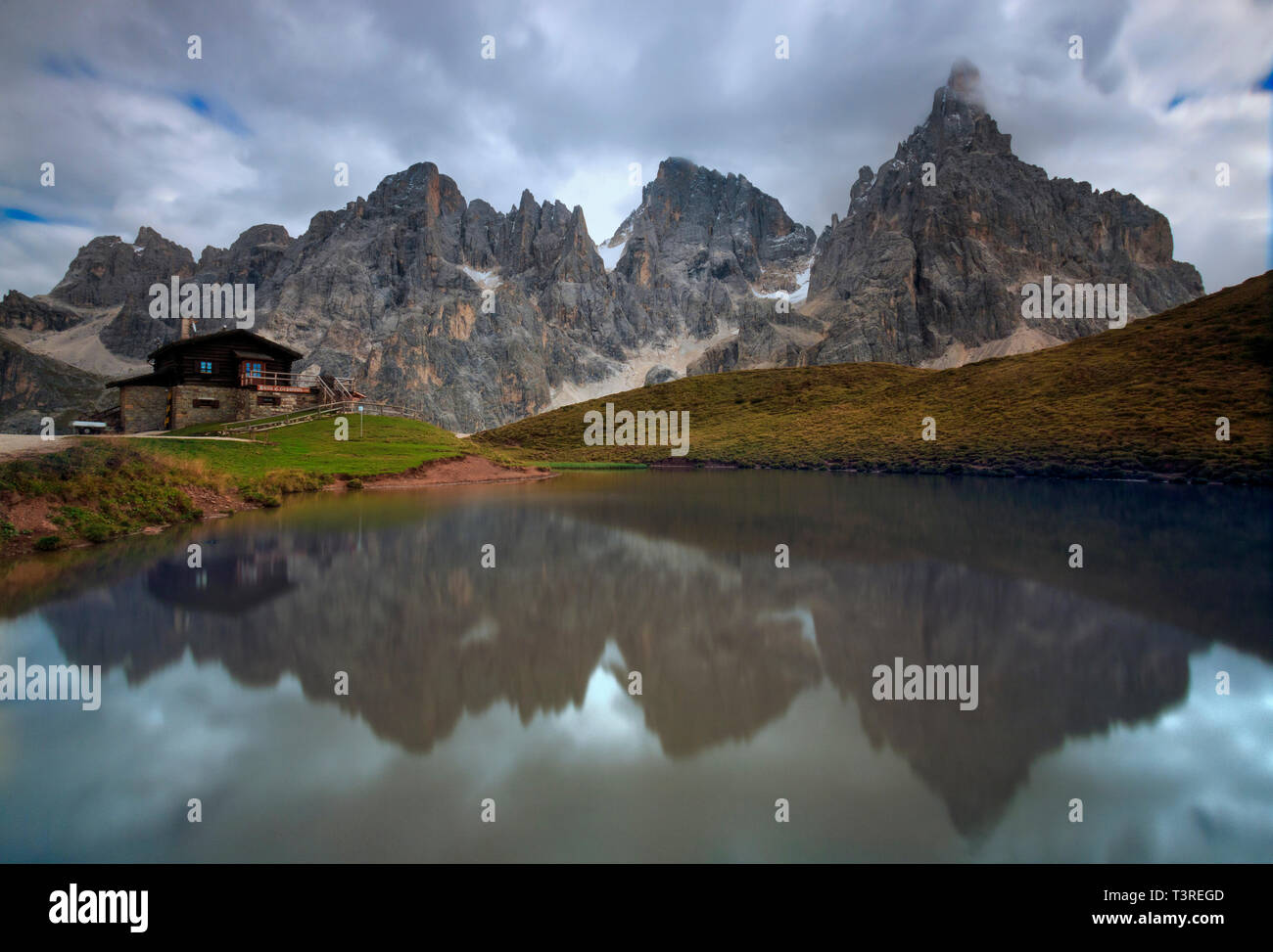 The whole range of the Pale di San Martino, one of the most famous and beautiful groups of the Dolomites, reflected in the waters of a small lake near Stock Photo