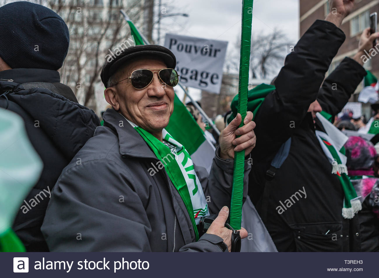 A smiling man, during the demonstration of the Algerian diaspora demanding the departure of President Bouteflika. Montreal, Canada. Montreal (Canada), - Stock Image