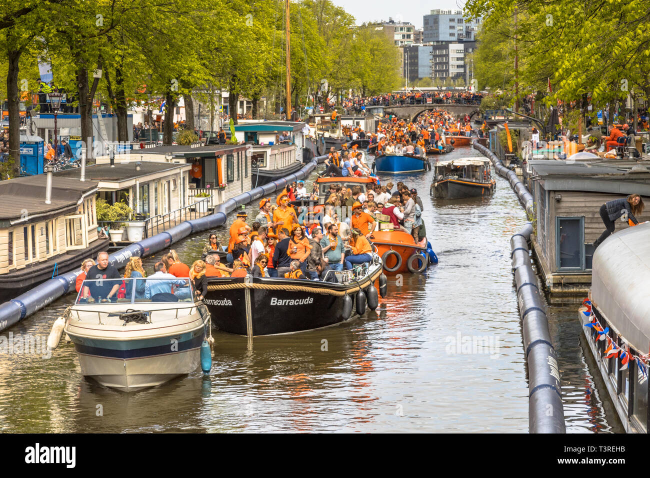 AMSTERDAM, THE NETHERLANDS - APRIL 27 2018: Canal boat parade on Koningsdag Kings day festivities. Birthday of the king. Stock Photo