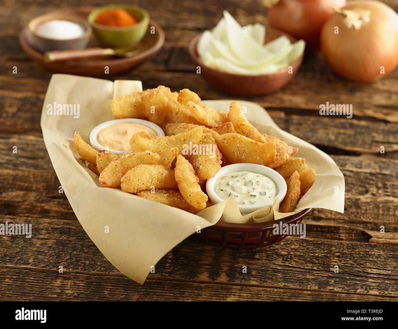 Fried Onion Petals with sauces - Stock Image