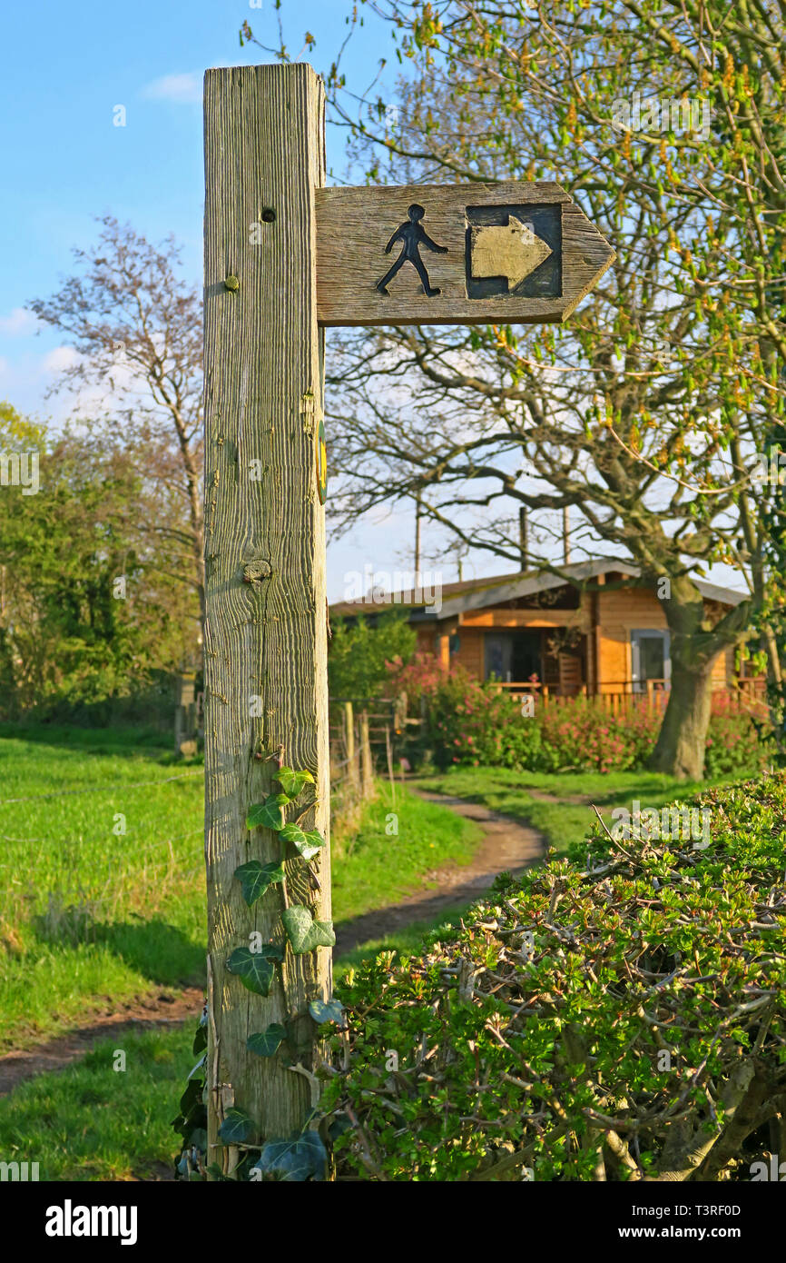Wooden footpath fingerpost sign in field, Australia Lane, Grappenhall, Warrington, Cheshire, UK - Stock Image