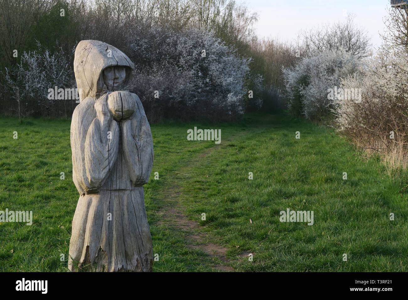 Carved wooden figure, at Grappenhall Wood, off Broad Lane, Grappenhall, South Warrington, Cheshire, England, UK - Stock Image