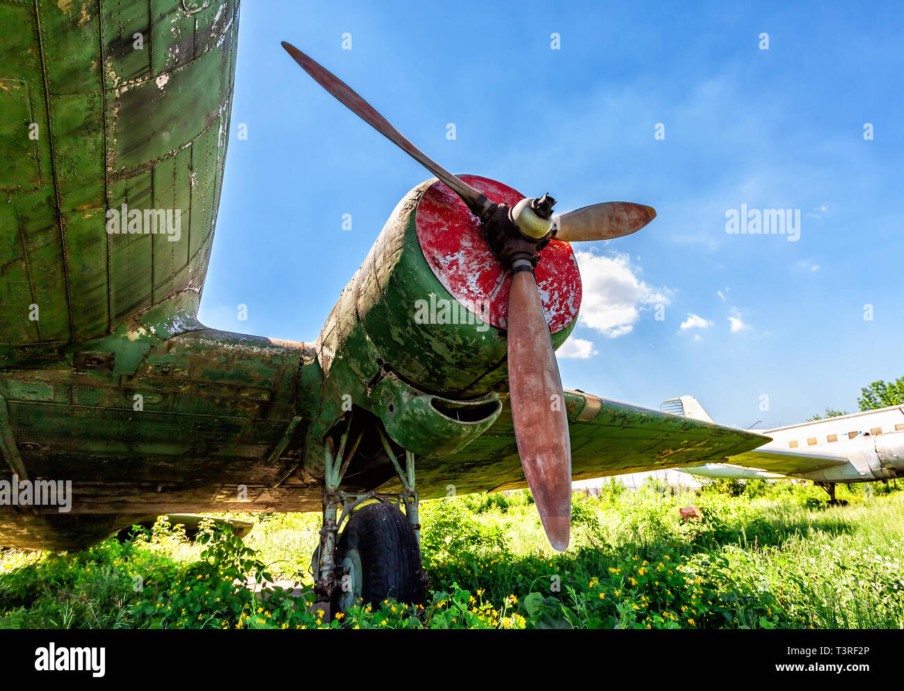 Turbine of an old russian turboprop aircraft at the abandoned aerodrome in summertime - Stock Image
