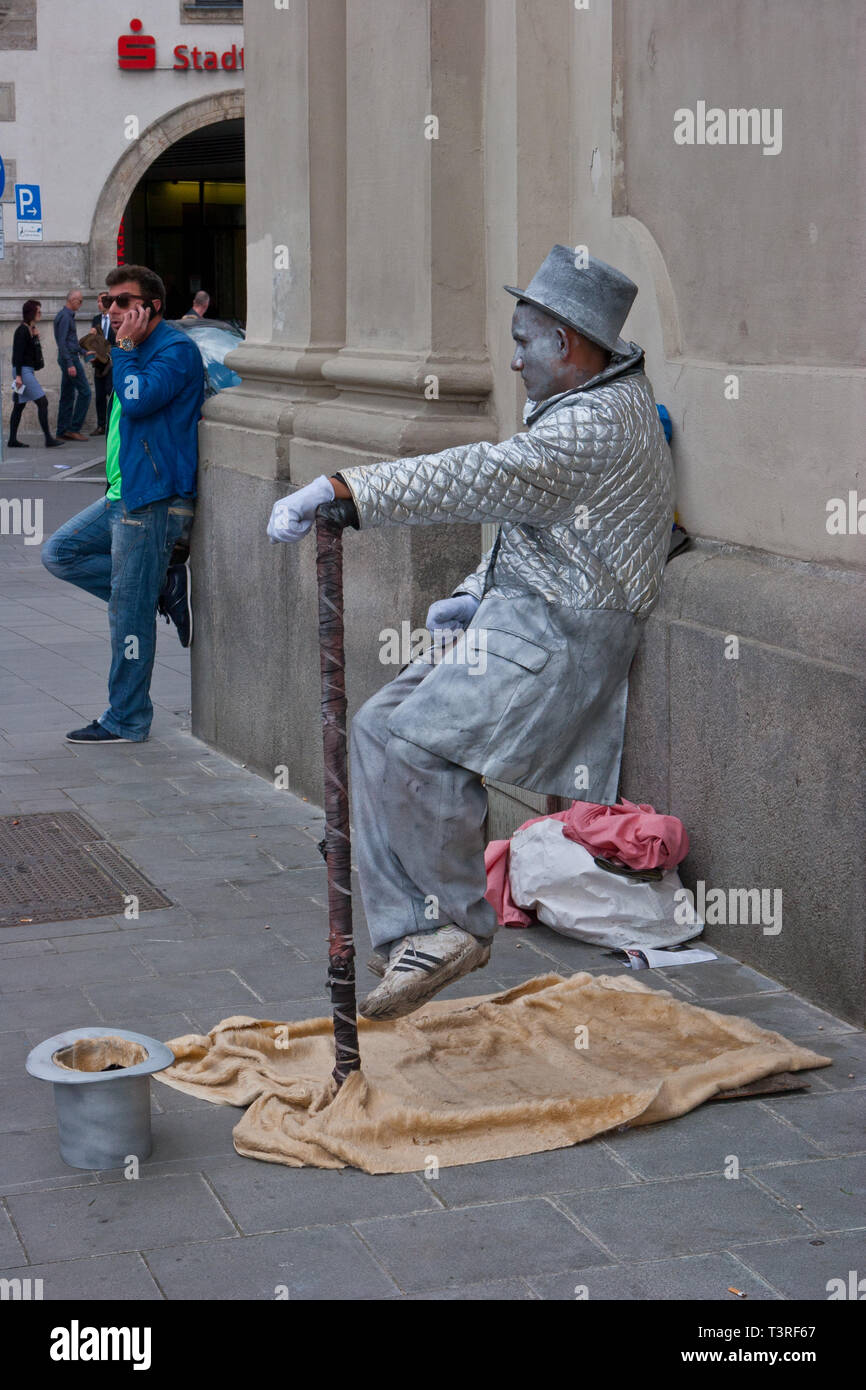 Mime performing outside the Holy Ghost Church, Munich, Germany - Stock Image