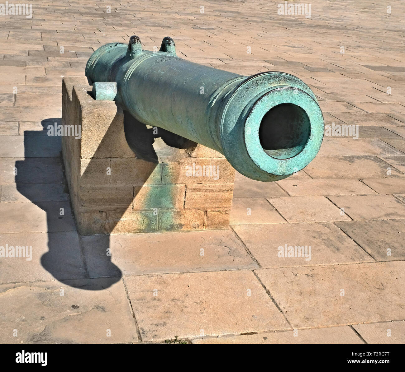 Old artillery gun. The gun for the cores, covered with patina. Located at the royal palace in Morocco - Stock Image