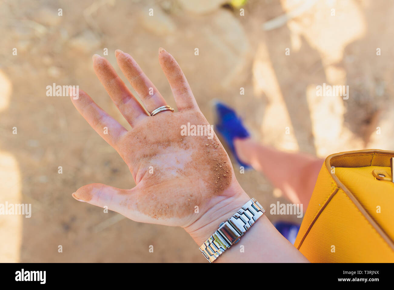 wipes dirty baby hands with a wet napkin. The concept of cleanliness and hygiene. - Stock Image