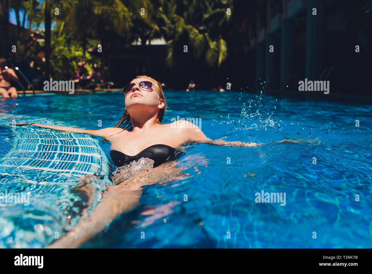 65c5a017dd7fd Beautiful Woman Relaxing In Swimming Pool Water. Girl With Healthy Tanned  Skin, Gorgeous Face
