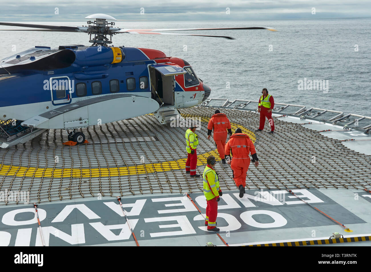 A CHC S92 Sikorsky helicopter on the deck of a Seismic Ship in the Norwegian North Sea conducting Crew Change for 2 Passengers. Norway - Stock Image