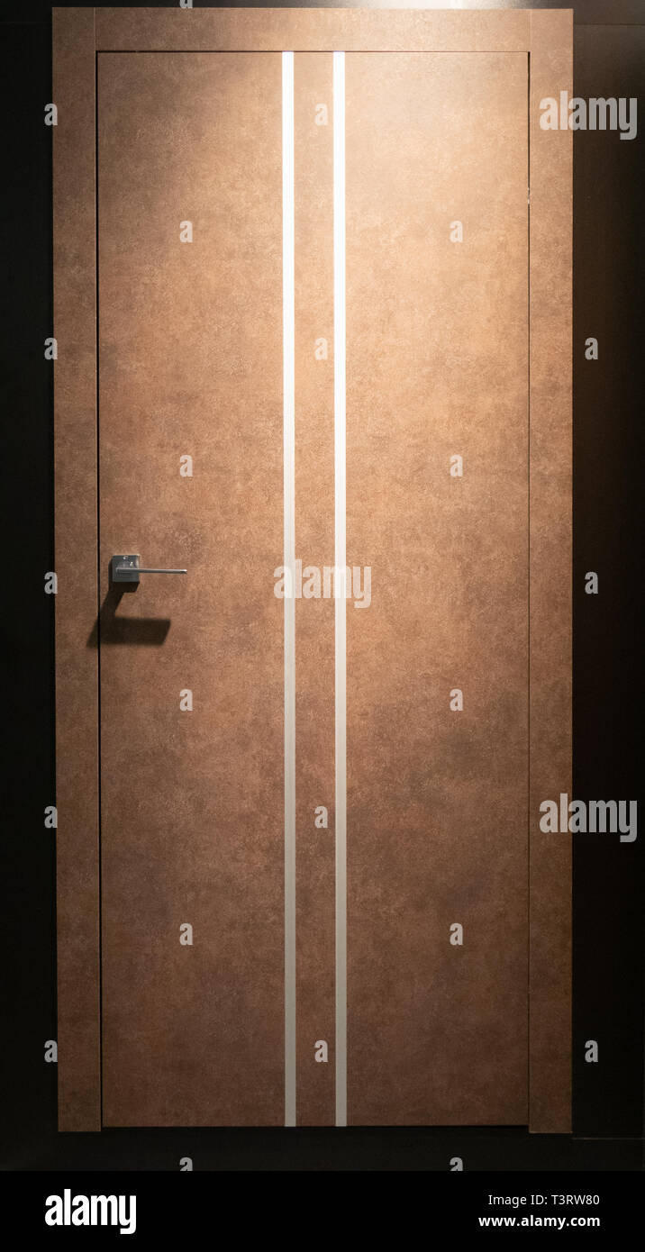 closed room door in brown color with two thin white stripes
