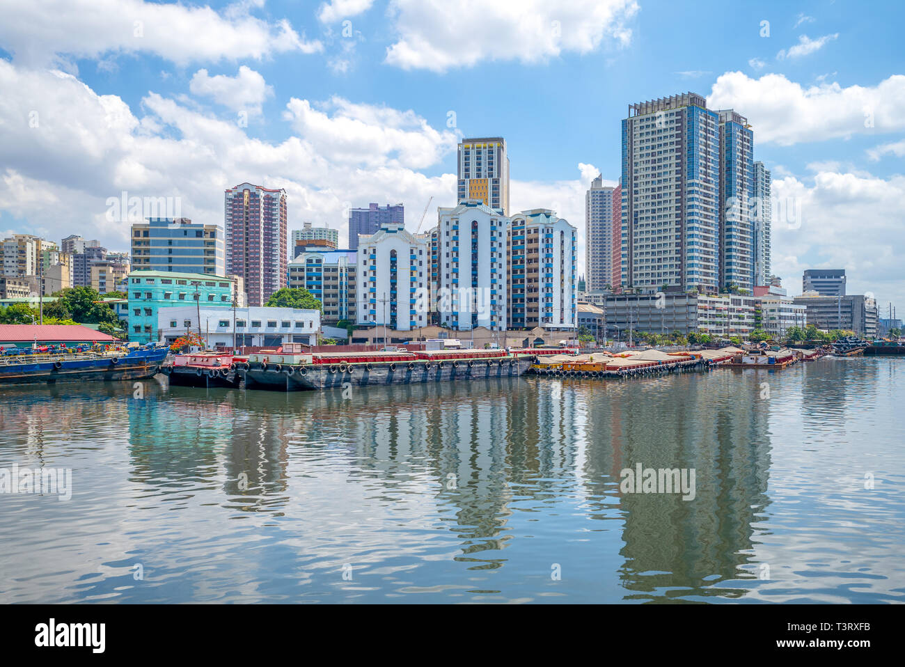 skyline of manila by Pasig River in philippines - Stock Image
